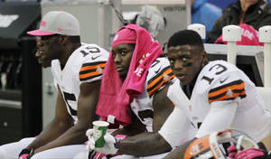 Photo -   Cleveland Browns running back Trent Richardson, center, looks on with teammates Josh Gordon (13) and Greg Little (15) during the second half of an NFL football game Sunday, Oct. 7, 2012, in East Rutherford, N.J. The Browns lost the game 41-27. (AP Photo/Kathy Willens)