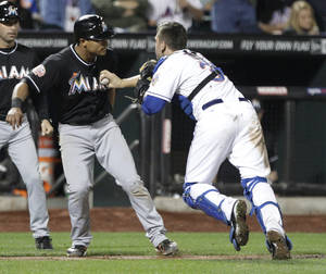 Photo -   Miami Marlins' Donovan Solano, second from left, is tagged out during a rundown by New York Mets catcher Josh Thole during the sixth inning of a baseball game on Friday, Sept. 21, 2012, in New York. (AP Photo/Frank Franklin II)