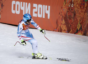 Photo - Austria's Matthias Mayer finishes to win the gold in the men's downhill at the Sochi 2014 Winter Olympics, Sunday, Feb. 9, 2014, in Krasnaya Polyana, Russia. (AP Photo/Gero Breloer)