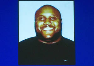 photo - In this image provided by the Irvine, Calif., Police Department via The Orange County Register, former Los Angeles police officer Christopher Jordan Dorner is shown. Dorner is a suspect in the killings of Monica Quan and her fiance, Keith Lawrence, who were found shot to death in their car at a parking structure Sunday night. (AP Photo/Irvine Police Department via The Orange County Register)