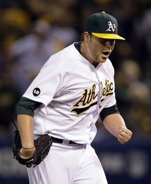 Photo -   Oakland Athletics starting pitcher Brett Anderson pumps his fist after Detroit Tigers' Omar Infante hit into a double play to end the top of the third inning during Game 3 of an American League division baseball series in Oakland, Calif., Tuesday, Oct. 9, 2012. (AP Photo/Marcio Jose Sanchez)
