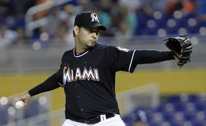 Photo -   Miami Marlins' Anibal Sanchez pitches during an interleague baseball game against the Toronto Blue Jays in Miami, Friday, June 22, 2012. (AP Photo/Alan Diaz)