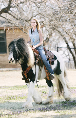 Photo - Trainer Lauren Fieseler of Lindsay rides Maladi at Randy and Brenda Hearons' horse ranch in Blanchard. PHOTO BY JACONNA AGUIRRE, THE OKLAHOMAN