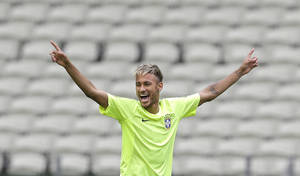Photo - FILE - This June 16, 2014 file photo shows Brazil's Neymar smiling as he holds out his arms during a training session at the Arena Castelao in Fortaleza, Brazil. Through one week of the World Cup, Facebook has already seen more people having more interactions about the tournament on the social media site than it had for the Sochi Olympics, Super Bowl and Academy Awards combined. A photo posted by Pitbull, who performed at the opening ceremonies, has received more than 1.2 million interactions, as has a photo posted by Brazilian soccer star Neymar, Facebook said. (AP Photo/Andre Penner)