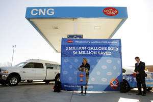 Photo - Gov. Mary Fallin speaks Thursday at an OnCue Express in Oklahoma City to celebrate its sale of 3 million gallons of compressed natural gas.  Photo by Garett Fisbeck, The Oklahoman