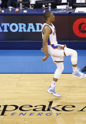 Photo - Russell Westbrook (0) is fired up during Game 2 of the Western Conference semifinals in the NBA playoffs between the Oklahoma City Thunder and the Los Angeles Clippers at Chesapeake Energy Arena in Oklahoma City, Wednesday, May 7, 2014. Photo by Sarah Phipps, The Oklahoman