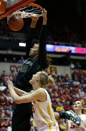 photo - Baylor center Brittney Griner, top, dunks the ball over Iowa State center Anna Prins during the first half of an NCAA college basketball game, Wednesday, Jan. 23, 2013, in Ames, Iowa. (AP Photo/Charlie Neibergall)