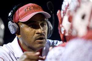 photo - Winston-Salem State head coach Connell Maynor speaks with one of his players during an NCAA college football game on Saturday, Dec. 8, 2012 at Bowman-Gray Stadium in Winston-Salem, N.C. (AP Photo/Winston-Salem Journal, Andrew Dye)