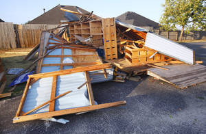 Photo - Storage building leveled by a storm at the Episcopal Church of the Resurrection, 13112 N. Rockwell Blvd., in Oklahoma City Tuesday, Aug. 9, 2011. A thunderstorm moved through the area Monday evening causing storm damage. Photo by Paul B. Southerland, The Oklahoman