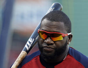 Photo - Boston Red Sox's David Ortiz waits to take batting practice during baseball practice Monday, Oct. 21, 2013, in Boston. The Red Sox are preparing to play the St. Louis Cardinals in Game 1 of the World Series on Wednesday. (AP Photo/Darron Cummings)