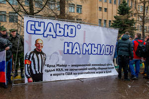 "Photo - In this handout photo provided by Young Guards of United Russia party press service shows a group of demonstrators holding a banner with a photo of American Ice Hockey referee Brad Meier and message reading "" Turn the referee into soap,"" which is indeed a Russian expression, as awful as it seems, as they protest against a controversial disallowed goal  Meier, who overturned Russia's third goal during the match between U.S. and Russia teams on Saturday near the U.S. Embassy in Moscow, Russia, Monday, Feb. 17, 2014. The demonstration was organized by the Young Guard, the youth wing of the Kremlin political party United Russia. (AP Photo/Voroshirin Dmitriy, Young Guards)"