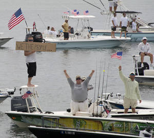 Photo - In this aerial photo provided by the Florida Keys News Bureau, boaters demonstrate against the closure of Everglades National Park waters Wednesday, Oct. 9, 2013, near Islamorada, Fla. About 100 boats took part in the dmonstration.  . (AP Photo/Florida Keys News Bureau, Andy Newman)