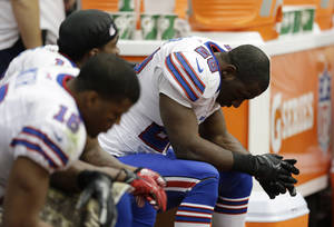 photo - FILE - In this Nov. 4, 2012, file photo, Buffalo Bills' C.J. Spiller (28) hangs his head on the sideline during the fourth quarter of an NFL football game against the Houston Texans in Houston.  The Bills have failed to qualify for the playoffs for 13 straight years. It's the longest current streak in the NFL. (AP Photo/Eric Gay, File)
