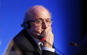 Photo - FIFA President Joseph Blatter listens to a question during a press conference one day before the draw for the 2014 soccer World Cup in Costa do Sauipe near Salvador, Brazil, Thursday, Dec. 5, 2013. (AP Photo/Victor Caivano)