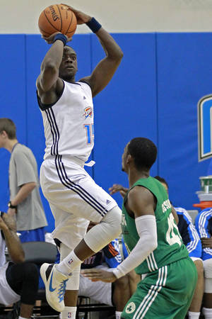 Photo - Oklahoma City Thunder's Reggie Jackson, left, shoots over Boston Celtic's Jonathan Gibson during an NBA summer league basketball game, Monday, July 9, 2012, in Orlando, Fla. (AP Photo/John Raoux) ORG XMIT: DOA107