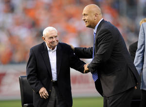 photo - FILE - In this Sept. 6, 2012, file photo, former Baltimore Orioles baseball player Cal Ripken, Jr., right, greets former manager Earl Weaver, left, during a pregame ceremony before a baseball game between the New York Yankees and the Orioles in Baltimore. Weaver, the fiery Hall of Fame manager who won 1,480 games with the Baltimore Orioles, has died, the team announced Saturday, Jan. 19, 2013. He was 82. (AP Photo/Nick Wass, File)