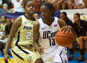 Photo -   Connecticut guard Brianna Banks, right, dribbles past Purdue guard April Wilson during an NCAA women's college basketball game in St. Thomas, U.S. Virgin Islands, Saturday, Nov. 24, 2012. Connecticut won 91-57. (AP Photo/Thomas Layer)