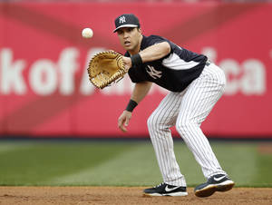 Photo - New York Yankees first baseman Mark Teixeira, who is on the disabled list, takes ground balls before a baseball game against the Boston Red Sox at Yankee Stadium in New York, Sunday, April 13, 2014.  (AP Photo/Kathy Willens)