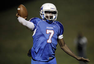 Photo - CLASS 2A PLAYOFFS: Millwood quarterback Kevonte Richardson (7) during the high school football game between Millwood and Washington,  Friday, Nov.  20, 2009, in Oklahoma City. Photo by Sarah Phipps, The Oklahoman