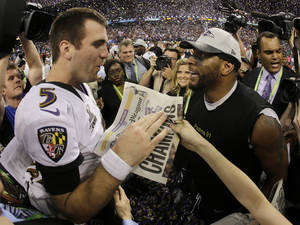 Photo - Baltimore Ravens quarterback Joe Flacco, left, and linebacker Ray Lewis celebrates their 34-31 win against the San Francisco 49ers in NFL Super Bowl XLVII football game, Sunday, Feb. 3, 2013, in New Orleans. (AP Photo/Matt Slocum)