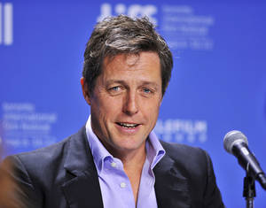 "Photo -   FILE - In this Sept. 9, 2012 file photo, actor Hugh Grant speaks during the news conference for the film ""Cloud Atlas"" during the 2012 Toronto International Film Festival in Toronto. Lord Justice Brian Leveson will release his report, Thursday, Nov. 29 2012, on a year-long inquiry into the culture and practices of the British press and his recommendations for future regulation to prevent phone hacking, data theft, bribery and other abuses. (AP Photo/The Canadian Press, Aaron Vincent Elkaim, File)"