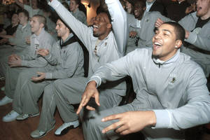 photo - From left, Lehigh University basketball players Dave Buchberger, Matt Shamis, Zahir Carrington and John Adams celebrate with teammates as they hear their school named as the opponent for No. 1 seed Kansas on Sunday in Bethlehem, Pa. AP Photo