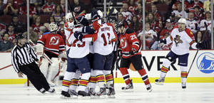 photo -   The Florida Panthers celebrate a goal by Mike Weaver during the second period of Game 3 of a first-round NHL hockey Stanley Cup playoff series against the New Jersey Devils, Tuesday, April 17, 2012, in Newark, N.J. (AP Photo/Julio Cortez)