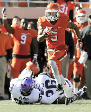 Photo - Oklahoma State's Josh Stewart returns a punt 95 yards for a touchdown against TCU on Saturday.  Photo by Nate Billings, The Oklahoman