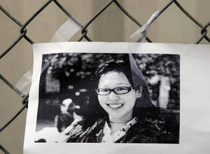 photo - A photocopy showing Elisa Lam  of Canada is displayed at a street memorial across the Cecil Hotel in Los Angeles Thursday, Feb. 21, 2013. Lam, a Canadian tourist, who was last seen last month. Los Angels Police say the body of a woman was found wedged in one of the water tanks on the roof was that of a missing Canadian guest. Investigators used body markings to identify 21-year-old Elisa Lam, police spokeswoman Officer Diana Figueroa said late Tuesday. (AP Photo/Damian Dovarganes)