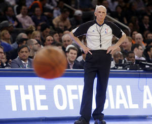 Photo - Referee Dick Bavetta (27) watches a free throw attempt during the second half of an NBA basketball game between the New York Knicks and the Brooklyn Nets Wednesday, April 2, 2014, in New York.  Bavetta worked his 2,633rd consecutive game assignment Wednesday, an ironman streak even longer than the one baseball Hall of Famer Cal Ripken Jr. compiled.   (AP Photo/Frank Franklin II)