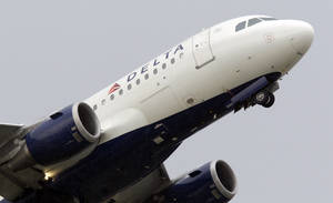 photo - FILE - In this July 22, 2011 file photo, a Delta Air Lines jet takes off at the Detroit Metropolitan Airport in Romulus, Mich. Delta Air Lines reported a first-quarter profit on Wednesday, April 25, 2012, as gains from hedging its fuel costs made up for losses in its day-to-day operations. (AP Photo/Carlos Osorio, File) ORG XMIT: NYBZ101