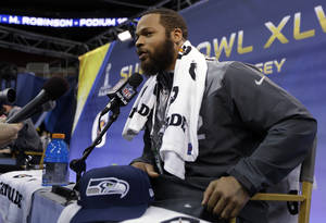 Photo - Seattle Seahawks' Michael Bowie answers a question during media day for the NFL Super Bowl XLVIII football game Tuesday, Jan. 28, 2014, in Newark, N.J. (AP Photo/Jeff Roberson)
