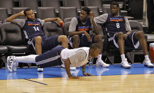 photo - NBA BASKETBALL: Reggie Jackson does pushups in front of Daequan Cook, Royal Ivey and Nazr Mohammed during the NBA Finals practice day at the Chesapeake Energy Arena on Monday, June 11, 2012, in Oklahoma City, Okla. Photo by Chris Landsberger, The Oklahoman