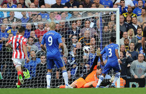 Photo -   Chelsea's Ashley Cole, right, scores against Stoke City during the English Premier League soccer match at Stamford Bridge, London, Saturday Sept. 22, 2012. Chelsea won the match 1-0. (AP Photo/PA, Anthony Devlin) UNITED KINGDOM OUT NO SALES NO ARCHIVE