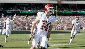 Photo - OU's Sam Bradford celebrates after running for a touchdown during the college football game between the University of Oklahoma and  Texas A&M University at Kyle Field in College Station,  Texas, Saturday, November 8, 2008. BY BRYAN TERRY, THE OKLAHOMAN