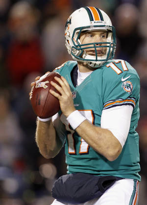 Photo -   Miami Dolphins quarterback Ryan Tannehill (17) looks to pass during the first half of an NFL football game against the Buffalo Bills, Thursday, Nov. 15, 2012, in Orchard Park, N.Y. (AP Photo/Gary Wiepert)