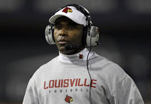 Photo - FILE - In tihs Dec. 5, 2013, file photo, Louisville head coach Charlie Strong watches from the sidelines in the first half of an NCAA college football game against Cincinnati in Cincinnati. New Texas football coach Strong says he is excited to lead one of the premier programs in the country, calling the Longhorns job a dream. In a statement released by the school formally announcing the hire Sunday, Jan. 5, 2014, Strong called Texas a special program because of its history, tradition and pride. (AP Photo/Al Behrman, File)