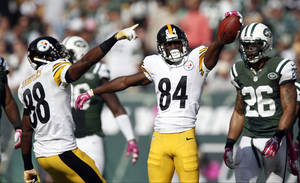 Photo - Pittsburgh Steelers wide receiver Antonio Brown (84) and teammate Emmanuel Sanders (88) react after a catch during the second half of an NFL football game against the New York Jets, Sunday, Oct. 13, 2013, in East Rutherford, N.J. The Steelers won 19-6. (AP Photo/Kathy Willens)