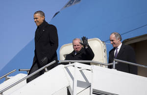 Photo - President Barack Obama, followed by Rep. Michael Doyal, D-Pa., center, and Sen. Bob Casey, D-Pa., right, arrive at the 171st Air Refueling Wing Pennsylvania Air National Guard on Air Force One, Wednesday, Jan. 29, 2014, in Coraopolis, Pa., as he travels to speak at the U.S. Steel Irvin Plant, in West Mifflin, Pa., to speaks about retirement policies he highlighted in the State of the Union Address. (AP Photo/Carolyn Kaster)
