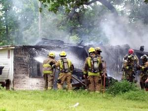 Photo - Firefighters spray down hot spots at a house at 1720 E Eubanks Street in  Oklahoma  City that exploded Monday, May 11, 2009. Photo by Johnnie Swanson, for the Oklahoman.