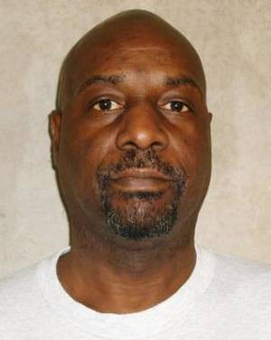 Photo - This photo provided by the Oklahoma Department of Corrections shows Ronald Clinton Lott, who was executed on Tuesday, Dec. 10, 2013, for brutally killing two elderly women more than a quarter-century ago. (AP Photo/Oklahoma Department of Corrections)