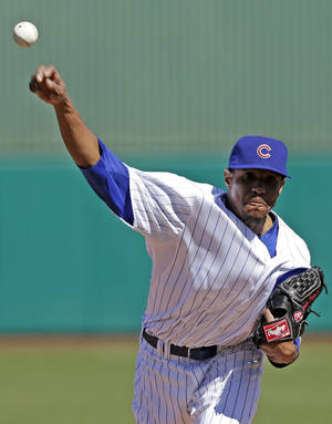 photo - Chicago Cubs starting pitcher Edwin Jackson throws before the first inning of an exhibition spring training baseball game against the Colorado Rockies, Tuesday, Feb. 26, 2013, in Phoenix. (AP Photo/Morry Gash)