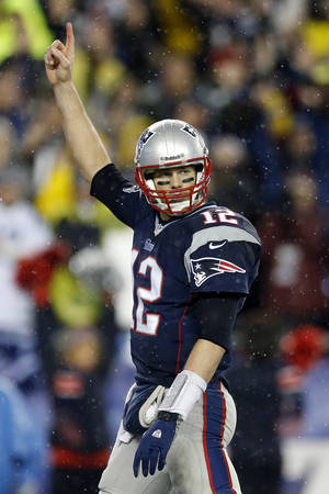 Photo - New England Patriots quarterback Tom Brady celebrates running back Stevan Ridley's touchdown during the second half of an AFC divisional NFL playoff football game against the Indianapolis Colts in Foxborough, Mass., Saturday, Jan. 11, 2014. (AP Photo/Michael Dwyer)