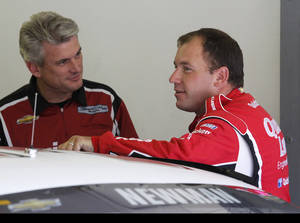 Photo - Ryan Newman, right, talks with a member of his crew during practice for Sunday's NASCAR Sprint Cup Series auto race at New Hampshire Motor Speedway, Friday, Sept. 20, 2013, in Loudon, N.H. (AP Photo/Mary Schwalm)