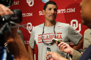 Photo - Oklahoma co-offensive coordinator Jay Norvell talks after an OU college football practice in Norman, Okla., Tuesday, August 7, 2013.  Photo by Bryan Terry, The Oklahoman