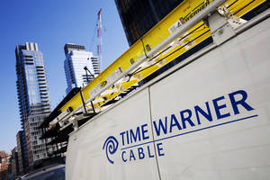 Photo - FILE - In this Feb. 2, 2009, file photo, a Time Warner Cable truck is parked in New York. Time Warner Cable says a problem that occurred during routine maintenance caused a nationwide outage of its Internet service for hours, early Wednesday, Aug. 27, 2014. (AP Photo/Mark Lennihan, File)