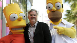 "Photo -   FILE - In this Feb. 14, 2012 file photo, Matt Groening, creator of the animated series ""The Simpsons,"" poses with his character creations Bart Simpson, left, and Homer Simpson after he received a star on the Hollywood Walk of Fame in Los Angeles. One of the best-kept secrets in television history has been revealed, with Groening pointing to Springfield, Ore. as the inspiration for the animated hometown of Homer and family. (AP Photo/Chris Pizzello, File)"