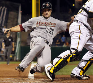 Photo -   Houston Astros' Brett Wallace (29) is forced out at home as Pittsburgh Pirates catcher Rod Barajas, right, throws to first to complete a double play on Astros' Carlos Corporan during the fourth inning of a baseball game in Pittsburgh, Wednesday, Sept. 5, 2012. The Pirates won 6-3. (AP Photo/Gene J. Puskar)
