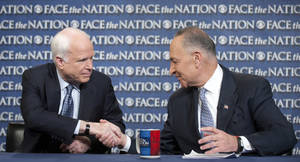 "Photo - In this photo released by CBS News Sen. John McCain, R-Ariz., and Sen. Chuck Schumer, D-N.Y., appear on Sunday, April 7, 2013, on's CBS's  ""Face the Nation"".  McCain and Schumer spoke about gun legislation, the latest developments with North Korea and immigration.  (AP Photo/CBS News, Chris Usher)"