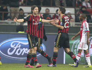 Photo - AC Milan midfielder Riccardo Montolivo, left, opens his arms after receiving a red card during a Champions League, Group H, soccer match between AC Milan and Ajax at the San Siro stadium in Milan, Italy, Wednesday, Dec. 11, 2013. (AP Photo/Antonio Calanni)